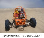 Man driving a sand buggy in...
