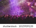 a crowded concert hall with... | Shutterstock . vector #1015939120