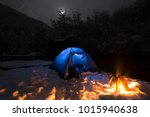bonfire makes snow around the... | Shutterstock . vector #1015940638