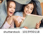 slumber party. adorable teenage ... | Shutterstock . vector #1015950118