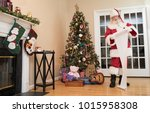 santa reading his naughty or... | Shutterstock . vector #1015958308