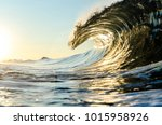 A Wave Breaking At Sunrise In...