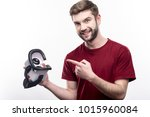 nice device. upbeat young man... | Shutterstock . vector #1015960084