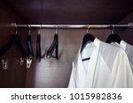 white bathrobe with hanger in... | Shutterstock . vector #1015982836