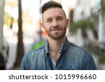 man in city smile happy face | Shutterstock . vector #1015996660