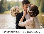 portrait of a young bridegroom... | Shutterstock . vector #1016032279