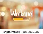 weekend loading word on blurred ... | Shutterstock . vector #1016032609