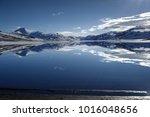 an absolutely calm lake... | Shutterstock . vector #1016048656