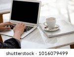 man typing keyboard laptop with ... | Shutterstock . vector #1016079499