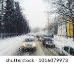blurred view of winter street... | Shutterstock . vector #1016079973