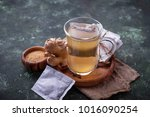 ginger root and tea bags.... | Shutterstock . vector #1016090254