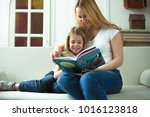 mom  read to me a fairy tale.... | Shutterstock . vector #1016123818