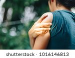 woman with pain in shoulder and ... | Shutterstock . vector #1016146813