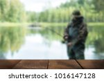 young man fishing blurred... | Shutterstock . vector #1016147128