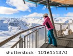 young woman skier looking at... | Shutterstock . vector #1016151370