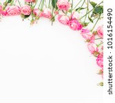 Stock photo floral frame made of pastel pink roses on white background flat lay top view 1016154490