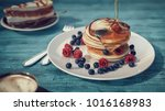 pour the honey onto the bread... | Shutterstock . vector #1016168983