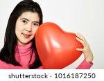 woman holding big red balloon... | Shutterstock . vector #1016187250