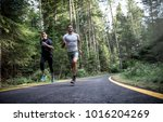 couple running in the forest | Shutterstock . vector #1016204269