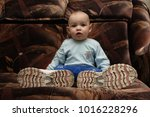 portrait of a child sitting in... | Shutterstock . vector #1016228296