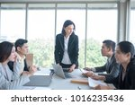 a group of business partners... | Shutterstock . vector #1016235436