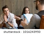 frustrated young man listening... | Shutterstock . vector #1016243950