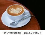 coffee latte art with heart... | Shutterstock . vector #1016244574