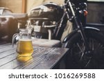 beer on the wooden table with... | Shutterstock . vector #1016269588