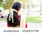 back view of indian woman with... | Shutterstock . vector #1016311738