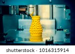 3d printer prints from the... | Shutterstock . vector #1016315914