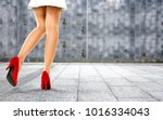 woman legs with red shoes and... | Shutterstock . vector #1016334043