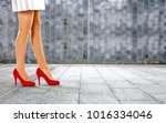 woman legs with red shoes and... | Shutterstock . vector #1016334046