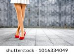 woman legs with red shoes and... | Shutterstock . vector #1016334049