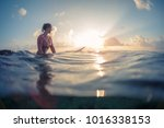 young lady surfer waits the... | Shutterstock . vector #1016338153