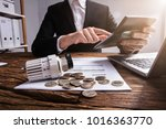 businessperson's hand... | Shutterstock . vector #1016363770