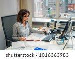 young secretary with earphones... | Shutterstock . vector #1016363983