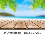 wooden table on summer beach... | Shutterstock . vector #1016367280