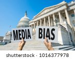 Small photo of Hands of protestors holding up signs calling attention to media bias in Washington, DC, USA