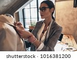 serious young woman in eyewear... | Shutterstock . vector #1016381200