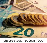 paper euro banknotes and coins. ... | Shutterstock . vector #1016384500
