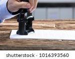 close up of a businessperson's... | Shutterstock . vector #1016393560