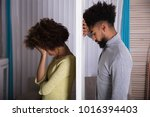side view of young unhappy...   Shutterstock . vector #1016394403