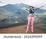 welcome etna  italy. girl happy ... | Shutterstock . vector #1016395099