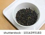 assam tea in a bowl | Shutterstock . vector #1016395183