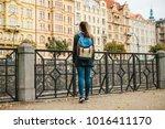 a beautiful tourist girl with a ... | Shutterstock . vector #1016411170