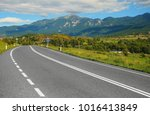 empty country road with road... | Shutterstock . vector #1016413849