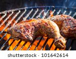 Close-up of chicken leg on the grill - stock photo