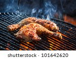 Flames frying chicken on the grill - stock photo