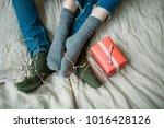 male crossing legs with woman... | Shutterstock . vector #1016428126