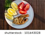 Fried fish in batter served with tomatoes - stock photo
